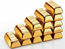 Gold today held near the highest in more than a week as investors weighed speculation the Federal Reserve will delay slowing stimulus