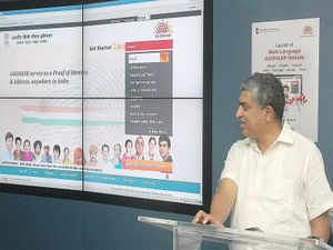 The UIDAI, which has run into controversies recently, came under fresh attack with the BJP alleging that the Aadhar card issued by it to citizens as a unique identification does not have Parliament's approval. In Pic: Nandan Nilekani, Chairman, UIDAI seen launching his Multilingual Aadhaar Website at UIDAI Tech Centre.