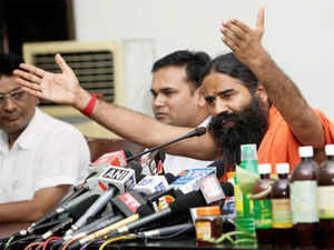 """Reacting to the development, Ramdev alleged that it was a """"conspiracy"""" by the Congress as he was """"exposing the party"""" during his tours."""