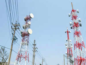 The telecom department could hold the 2G spectrum auctions in a two-stage bidding process in order to charge a premium for a contiguous band of bandwidth.
