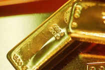 Gold today declined as some investors sold the metal after it rallied to a three-week high on speculation the Federal Reserve will maintain stimulus.