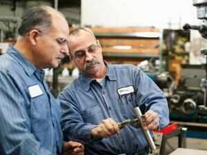 US manufacturing grew at its slowest pace in a year this month and factory output contracted for the first time since late 2009.