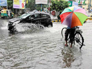 Three persons were also killed in heavy rains in south Bengal with normal life thrown out of gear in Kolkata and adjacent districts. (AP)