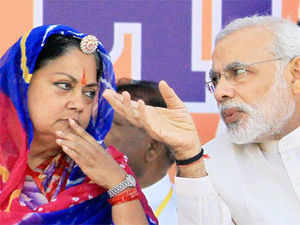 Narendra Modi combined an aggressive pitch for Vasundhara Raje with his ongoing attacks on Rahul Gandhi at an election rally on Saturday in Udaipur