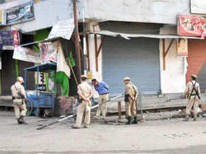The bomb was an improvised explosive device, but it was not immediately known whether it was planted or hurled at the market complex, police said.  File photo: Police men investigate a site in Imphal.