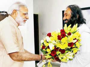 SMILES SAY ALL: Modi greets Sri Sri Ravi Shankar, founder of the Art of Living Foundation, in Gandhinagar