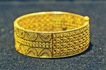 Gold prices dipped to nearly two-week lows at the domestic bullion market today on consistent selling by stockists amidst dull demand and weak global cues.