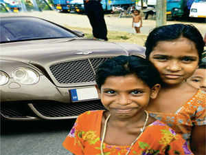 The pathetic picture of a Bentley car worth over a crore, waiting at a red light, besieged by begging children, is a new phenomenon.
