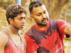 Praveen CM (seen here with national coach Keerthi Pais) is India's most accomplished male climber, having won 14 national gold medals, starting 2001; The bronze medallist at the international Trex Games in 2009 today makes a living building walls. Praveen was tasked with building the speed climbing wall for the national championships in Bangalore.