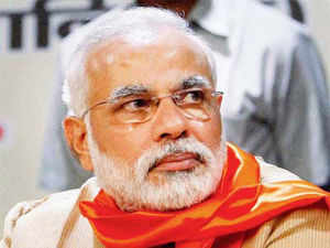 """Storming the capital with a whirlwind campaign, Narendra Modi today attacked Prime Minister Manmohan Singh and Finance Minister P Chidambaram, saying they have ruined the country with their """"bookish knowledge""""."""