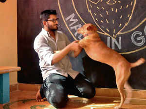 Abhisek Sarda, founder of Goa-based Beard Design and PPTSalon, in his office with his pet dog Bodoni