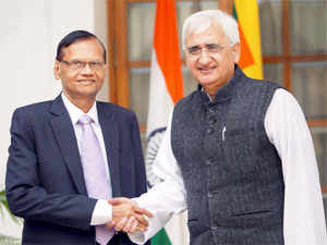 Sri Lankan Foreign Minister GL Peiris met his Indian counterpart Salman Khurshid in New Delhi Wednesday and sought the Manmohan Singh government's support.
