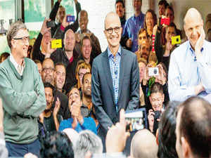 Satya Nadella (centre) addresses employees along with Bill Gates (left) and Steve Ballmer (right).