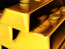 Gold prices moved down by 0.10% toRs29,851 per 10 grams in futures trade as speculators trimmed positions amid a weak trend in the global markets.