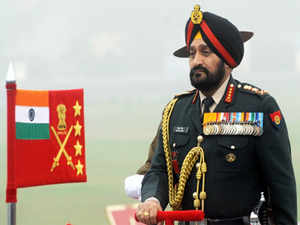 Indian Army Chief Bikram Singh inspects the guard of honour during the Army Day parade in New Delhi on January 15, 2014.A formation of tanks took part in the parade commanded by Colonel B Ravi as Army Chief General Bikram Singh bestowed the rare and prestigious honour.