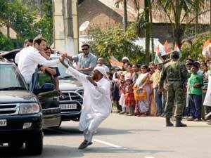 Congress Vice President Rahul Gandhi is greeted by one of his supporters during a road show in Nagaon on Wednesday.