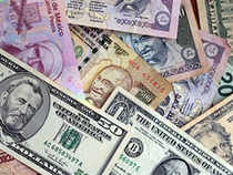 The rupee trimmed its initial losses but was still quoted lower by 8 paise to 62.06 against the US dollar in late morning deals today.