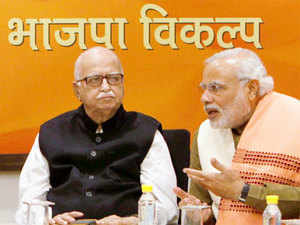 BJP patriarch LK Advani is just not ready to hang up his boots as he reiterated his wish on Friday to contest from Gandhinagar once again.In pic: File photo of Gujarat CM and BJP's PM candidate Narendra Modi and senior leader LK Advani during the party's Central Election Committee meeting in New Delhi.