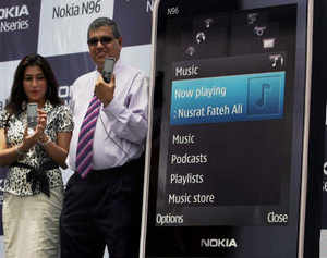 Nokia India's Devinder Kishore alongwith a model pose with an N96 in New Delhi.