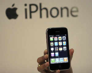 A man holds his new Apple iPhone at Telcel Center, Kolkata. More