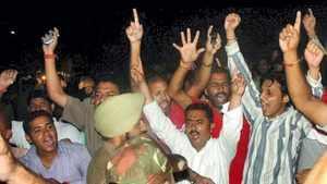 Activits of Shri Amarnath Sangarsh Samiti shout slogan against J&K Governor NN Vohra infront of Circuit House in Jammu on Saturday. PTI