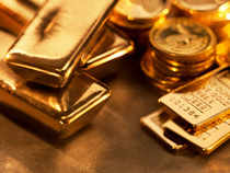 Globally, the yellow metal edged lower in listless trade as cautious investors awaited the US Federal Reserve policy statement as well as key economic data.