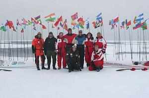 The team with the 192 flags they erected to symbolise the  that the Arctic belongs to all of us. (Frederick Kalborg)