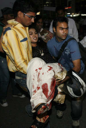 An injured being taken for treatment after a bomb explosion near Gopaldas Building at CP on Saturday. PTI