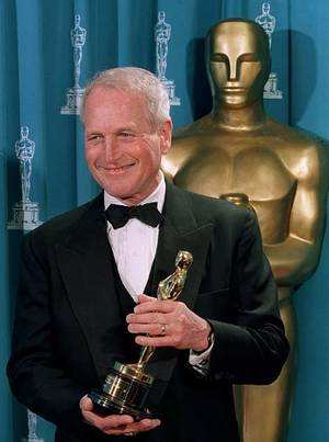 File Photo: US actor Paul Newman poses with the Jean Hershholt Humanitarian Award which was presented to him during the 66th Annual Academy Awards, in 1994. (AFP Photo)