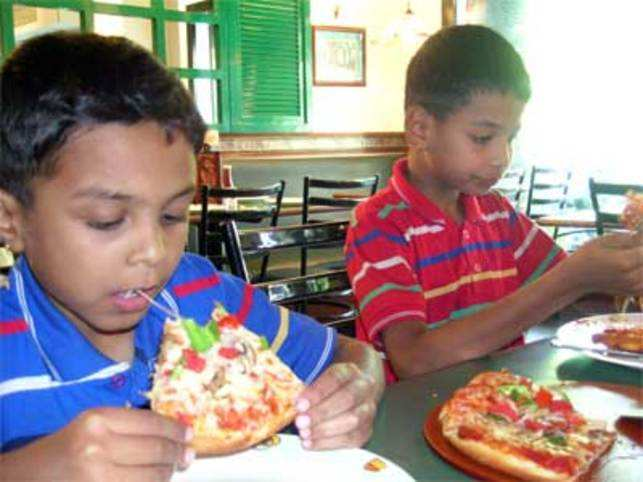 McDonald's, Pizza Hut, KFC, CCD & Domino's flourish: Quick Service Restaurant industry on a roll