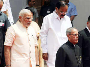 The most fascinating aspect about the first two weeks of Modi's PMship however is the ease with which he has slipped into the prime ministerial mode.In pic: President Pranab Mukherjee, Prime Minister Narendra Modi and Parliamentary Affairs Minister M Venkaiah Naidu, proceeds to Central Hall to address the joint session of Parliament in New Delhi on Monday.