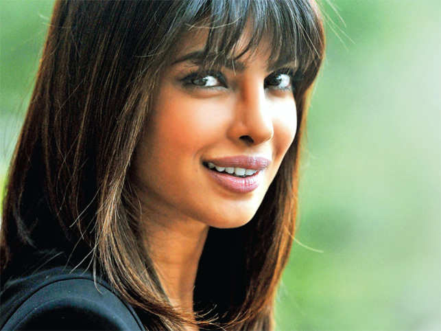 When she isn't conquering new frontiers, she drapes her legs around a Harley. Priyanka Chopra ticks all boxes