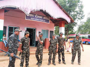 In this file photo, anti-naxal forces guard polling station at Naravi.
