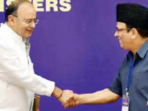 Finance minister Arun Jaitley greets J&K finance minister Abdul Rahim Rather during a meeting with state FMs in New Delhi on July 3, 2014.