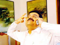 The Adani Group is among the most indebted companies in India and an equity fund-raising would help it ease the leverage on its balance sheet.  In Pic: Gautam Adani talking on the phone