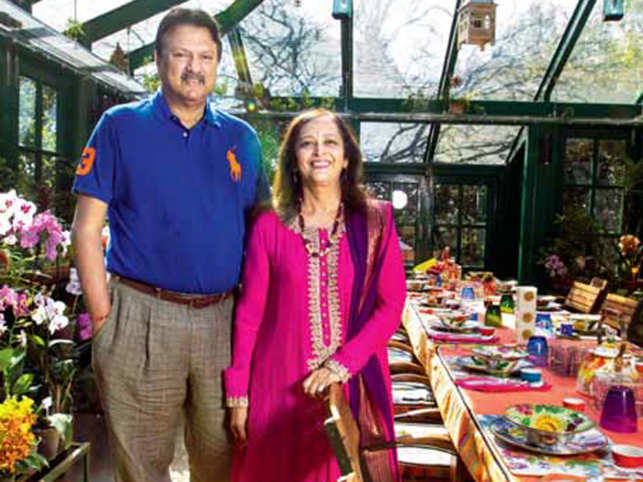 Ajay andSwatiPiramalin their conservatory. It's a place where thePiramalsoften host board meetings. The table is permanently set for brunch when the family is in residence at Greenwoods.