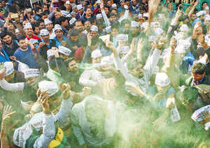 Early holi for Aam Aadmi: AAP supporters celebrating their victory outside party headquarters in New Delhi on Tuesday