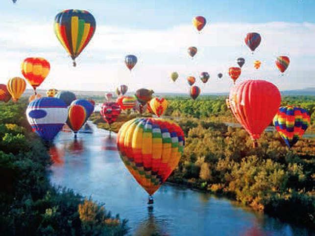 SKY'S THE LIMIT: Hot air balloons ascending at the Albuquerque International Hot Air Balloon Festival. (Image: © Mark Newman - Rainbow/Science Faction/Corbis)