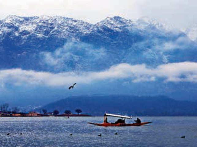 BLUE PRINTS: Capture the calm waters amidst the Himalayas overlooking a shikara in Dal Lake, Srinagar.