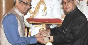 Bibek Debroy conferred with the Padma Shri Award