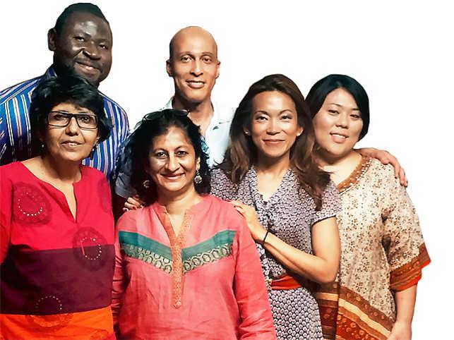 Marina Tanaka (far right) with the volunteer team and the founders of Akshara,Nandita Gandhi and Nandita Shah (front)