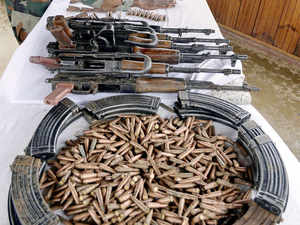 In pic: Army displays huge cache of arms and ammunation recovered from Lashkar-e-Taiba (LeT) hideout during an anti-militant search operation at Sagipora forest area of Zalura Baramulla in Kashmir. PTI Photo