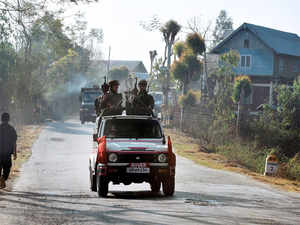 A vehicle carrying armed security personnel passes along a road on the outskirts of Imphal, Manipur (File photo).