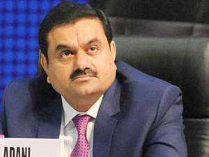 The group's arm Adani Renewable Energy Park has signed a pact with Rajasthan govt for a 50:50 JV for the solar power project.