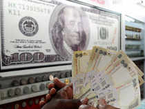 The local currency gained as dollar was seen weakening against a basket of major currencies ahead of the US Federal Reserve's policy review starting today.
