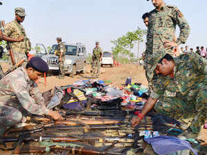 CRPF personnel recover arms and ammunitions after an encounter with Maoist rebels in Palamu in Jharkhand on June 16, 2015.