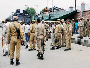 Heavy Police personnel deployed around Civil Secretariat in Srinagar on Monday after the killing of a civilian by unidentified gunman in Sopore.