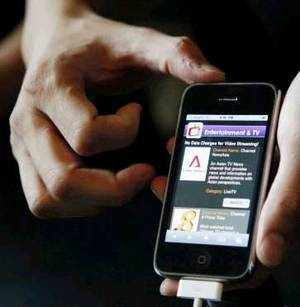 A Singtel staff holds an Apple iPhone 3GS ahead of the phone launch in Singapore. (REUTERS)