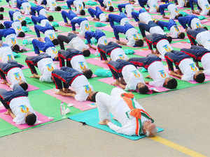 Prime MinisterNarendraModialong with officials of various ministries alsopractisedyoga 'asanas' during the event atRajpath.