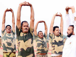 In pic: BSF personnel perform yoga on International Yoga Day in Khasa on the outskirts of Amritsar
